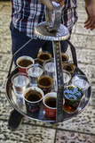 Young Man Holding a Tray with Coffee  Tea and Water in Old City  Jerusalem  Israel  Middle East