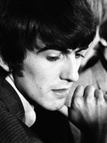 George Harrison  a Member of Music group The Beatles  During an Interview