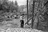 Muhammad Ali Chopping Down Trees as Part on His Training Routine
