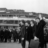 The Beatles Fly Off to Crying Fans  1965