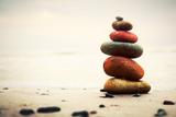 Stones Pyramid on Sand Symbolizing Zen  Harmony  Balance Ocean in the Background