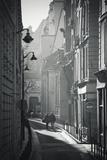Two People Walking Up Sunny Side Street Near St Michel Notre Dame in Paris  France