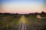 Children Playing on Train Tracks at Sunset in Zambia