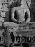 Monk in Front of the Seated Buddha Statue  Gol Vihara  Polonnaruwa  Sri Lanka  Asia