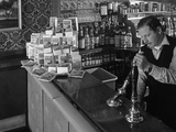 A Pub Landlord with a Display of the Batchelors 5 Day Catering Pack on His Bar  1968