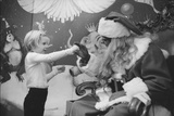 Boy Kissing African American Santa Claus in Unidentified Department Store 1970