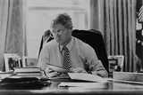 Informal Portrait of President Bill Clinton at His Desk in the Oval Office