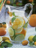 Jug of Water with Citrus Fruit  Lemon Balm and Ice Cubes