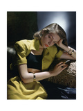Actress Lauren Bacall Wearing Yellow Bare-Midriff Suit with Black Halter from B H Wragge