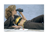 Model Is Reclining Wearing Brown Pant Suit with Yellow and Brown Halter by Ken Scott