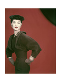 Model Nancy Berg Wearing a Brown Velvety Wool Dress by Adele Simpson