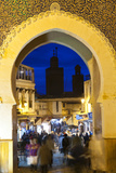 Blurred People Passing Through the Blue Gate  Fez  Morocco