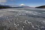 Ice on Lake Yamanaka with Snow-Covered Mount Fuji in Background  Japan