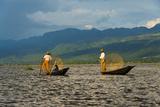 Intha Fisherman Rowing Boat with Leg on Inle Lake  Shan State  Myanmar