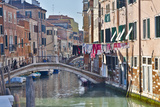 Work Boats and Bridge Along Canals of Venice  Italy