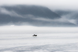 A Lone Fisher Boat Heading Out in the Fog of Morning Seward  Alaska