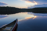 A Canoe on Little Berry Pond in Maine's Northern Forest Sunset