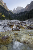 A River Streams over Rocks in Val Canali