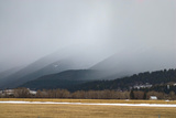 A Spring Storm Hovers over a Barn in Cottonwood Canyon of the Gallatin Range  Near Bozeman  Montana