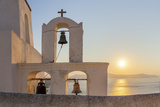 A Summer Sunset on the Mediterranean Island of Santorini  with a Historic Church and a Bell Tower