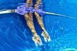 Ballerinas Dancing Underwater in a Swimming Pool