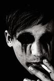 Young Man with Blackened Eyes Smoking