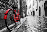 Retro Vintage Red Bike on Cobblestone Street in the Old Town Color in Black and White Old Charmin