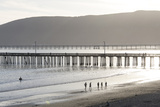 USA  California  Avila Beach Silhouetted Beach Walkers Approach Pier End of Day