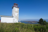 Martins  New Brunswick  White Old Traditional Historic Lighthouse Ion Water with Fields on Cliff