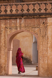 Lady in Traditional Dress Walking Through a Gateway in the Amber Fort Near Jaipur  Rajasthan  India