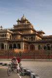 Rickshaw Rider Resting Outside the Ornate Albert Hall Museum in the City of Jaipur  India