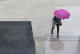 Woman with Umbrella and Mobile Phone Walking Up Steps to Auckland Art Gallery