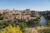 The River Tagus with the Alcazar and Cathedral Towering Above the Rooftops of Toledo  Spain