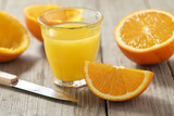 Sliced Oranges and Glass with Fresh Orange Juice