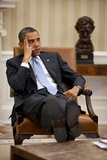 President Barack Obama Listens During to Advisors in the Oval Office