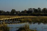 A Long Wooden Bridge over a Spillway