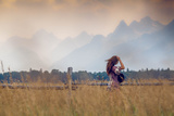 A Woman Watches a Storm Brew over the Tetons
