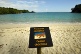 A Sign Warns People from Swimming in the Waters of Playa Manuel Antonio
