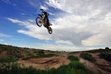 A Rider Jumps High in the Air at a Motocross Event