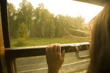 A Woman Looking Through a Train Window  Siberia  Russia