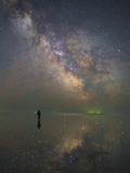 Man Stands Alone on Lake Elton in Russia under the Center of the Milky Way