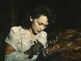 Woman Aircraft Worker Checking Electrical Assemblies