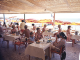 Taking Lunch in a Shaded Restaurant by the Shore in Juan Les Pins on the French Riviera  France