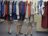 Fashion Models Behind a Suit Rack Trying on Clothes at Zelinka-Matlick  New York  New York  1960