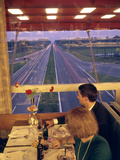 An Italian Couple Take their Supper in One of the Highway-Spanning Restaurant of the Pavesi Chain