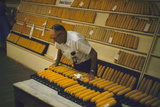 1955: at the Iowa State Fair  a Judge Examine Corn Cob Entries  Des Moines  Iowa