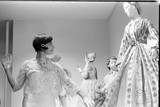 Drinking Guest Looking at a Display at the Met Fashion Ball  New York  New York  November 1960