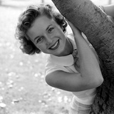 Portrait of American Actress Debbie Reynolds as She Poses Behind a Tree  1950