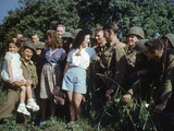 US Soldiers Gather around a French Girl Near Avranches  France  August 1944