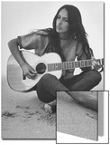 Folk Singer Joan Baez Strumming Her Guitar on the Beach Near Her Home